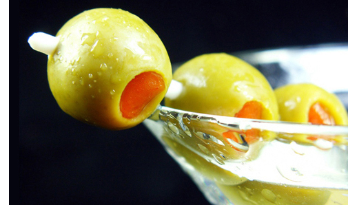 photo of martini glass with olives
